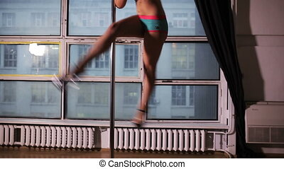 Young woman pole dance