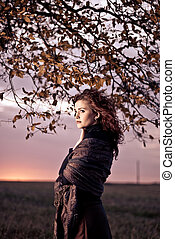 young woman portrait at fall tree