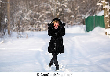Young woman portrait, at snowy winter outdoor.
