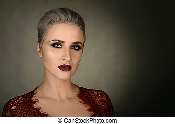 Young woman portrait. Closeup beauty studio shoot. Healthy clean skin and perfect makeup on beautiful face of white model with short blonde hair