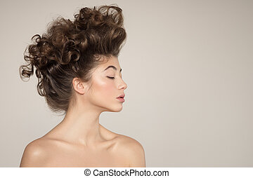 Young woman portrait. Creative hairstyle.