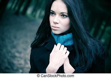 Young woman portrait. Soft blue tint.