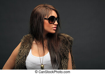 young woman portrait with big fashion sunglasses