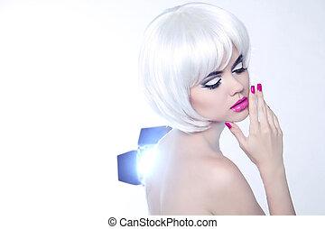 Young woman portrait with fashion makeup and nail polish, studio shot