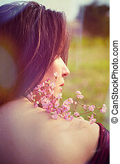 young woman portrait with flowers outdoor back