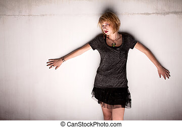 Young Woman Posed Against cement Wall
