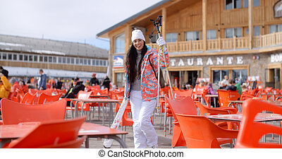 Young woman posing at a ski resort restaurant
