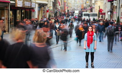Young woman posing, busy street, people walking around, HD