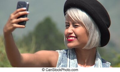 Young Woman Posing For Selfies
