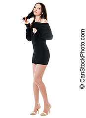 Young woman posing in dress - Young playful woman posing in...