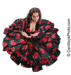 young woman posing in flamenco costume isolated