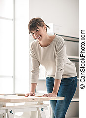 Young woman posing in her office