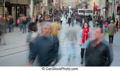 Young woman posing in street