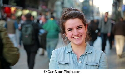 Young woman posing in street - Portrait of happy young woman...