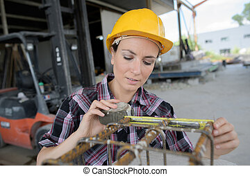 young woman posing in the factory