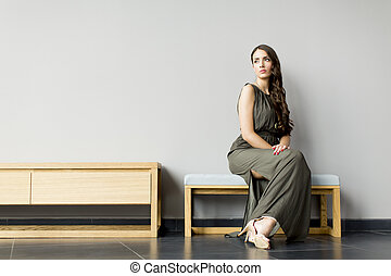 Young woman posing in the room