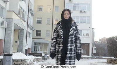 Young woman posing near high-rise building - Young woman in...