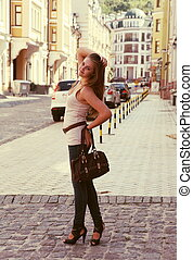 Young Woman Posing on the Urban Street