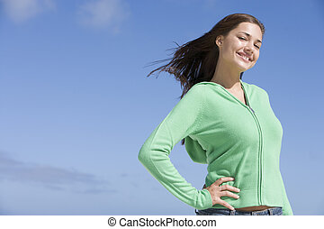 Young woman posing outdoors