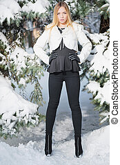 Young woman posing standing in winter