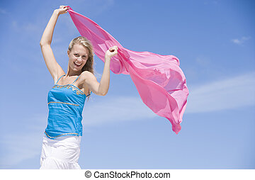Young woman posing with a scarf