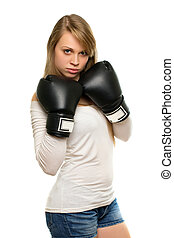 Young woman posing with boxing gloves
