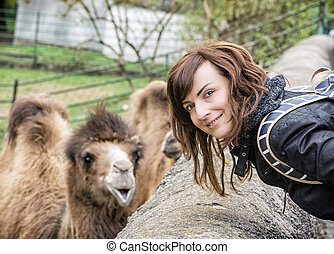 Young woman posing with camel