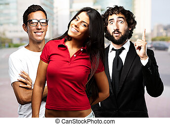 young woman posing with friends at city