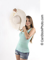 young woman posing with hat