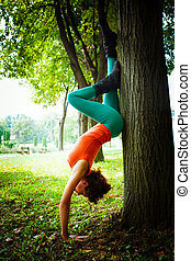young woman practice balance outdoor
