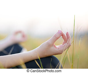 Woman Practices Yoga on the Meadow