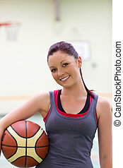 Young woman practicing basketball