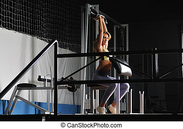 young woman practicing fitness and working out in a gymyoung woman practicing fitness and working out in a gym