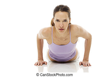 pregnant woman lying down and practicing yoga on isolated