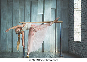 Young woman practising ballet