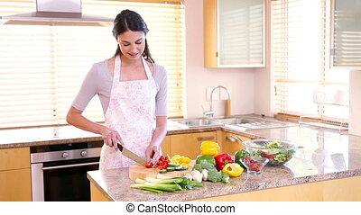 Young woman preparing a salad