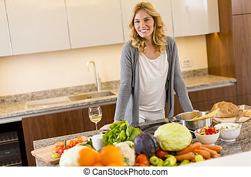 Young woman preparing food in modern kitchen