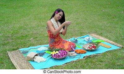 Young woman preparing garland in the garden 4k