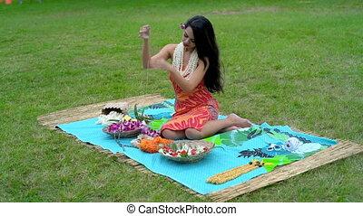 Young woman preparing garland in the garden 4k - Beautiful...