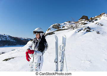 Young woman preparing to go skiing