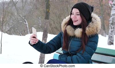 young woman preparing to take a selfie