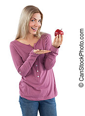 Young woman presenting an apple