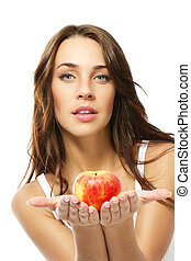 young woman presenting apple on white background