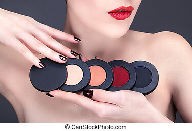 Young woman presents an assortment of blush