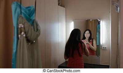 Young woman primp in the dressing room
