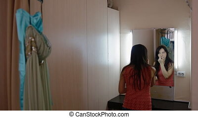 Young woman primp in the dressing room before photo shoot....