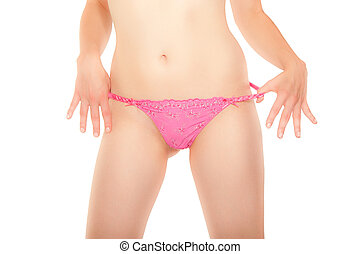 Young woman pulling pink panties