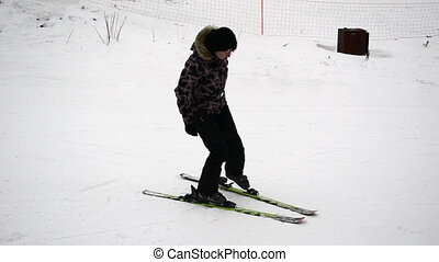 Young woman puts on skis and starts
