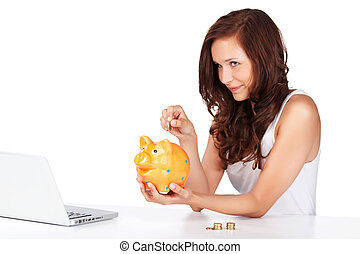 Young woman putting coins in her piggy bank