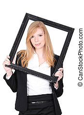 Young woman putting herself in a picture frame